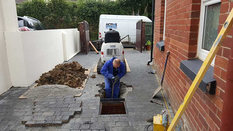 Man repairing a drain